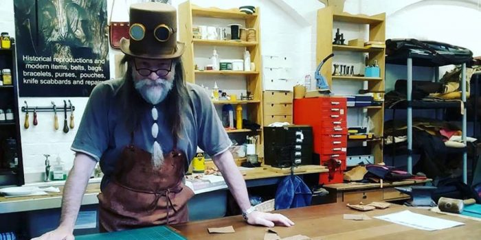 Leather worker at his counter