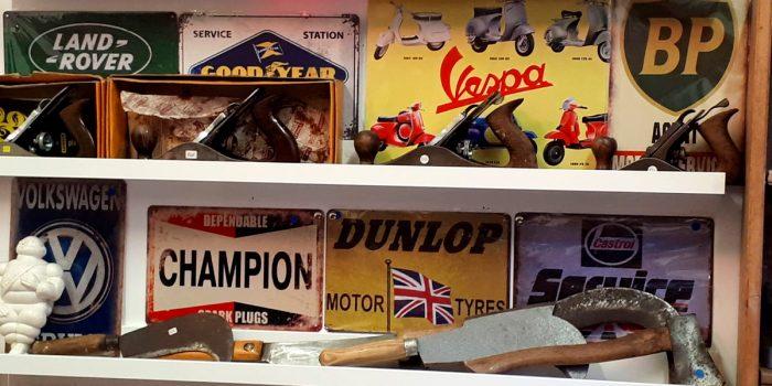 Vintage signs displayed on shelves
