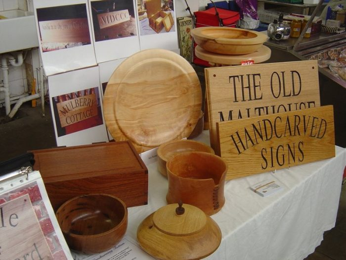 Various carved wooden items on Devizes Shambles Market Stall