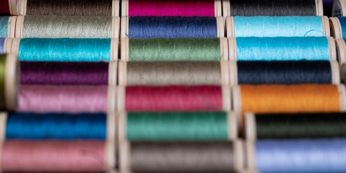 Reels of coloured cotton threads