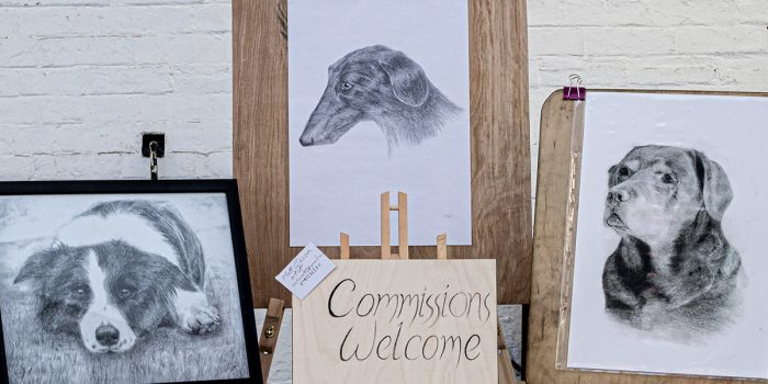 Dog drawings displays on easels