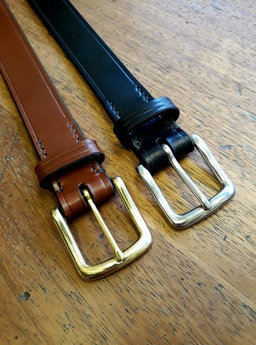 Two leather belts with buckles