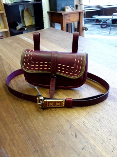 Brown leather shoulder bag with decorative stitching