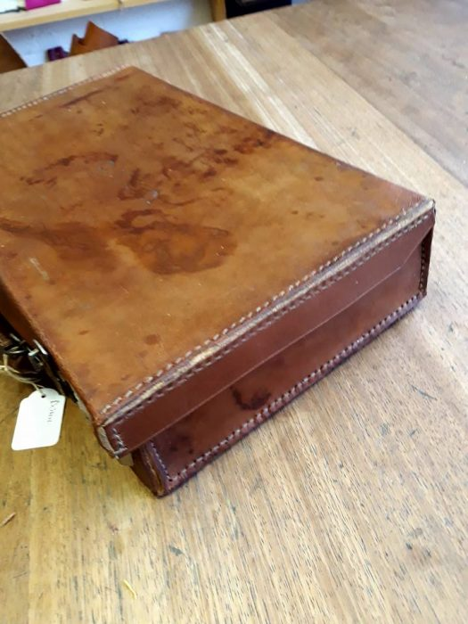 Leather suitcase on a table