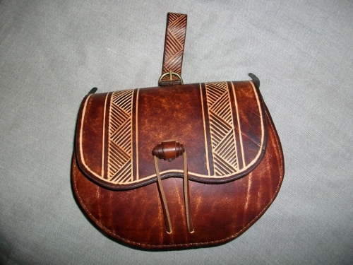 Intricately decorated leather bag