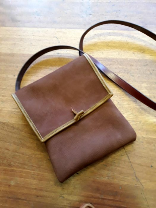 Brown and gold edged leather shoulder bag