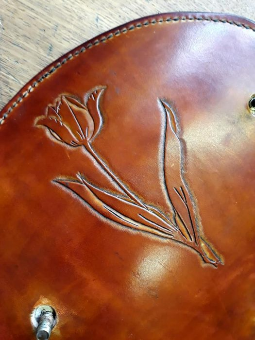 Hand-crafted leatherwork with embossed tulip