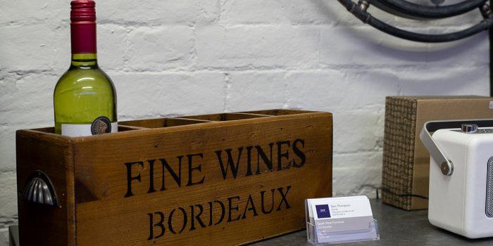 Fine wine box on shelf with a radio