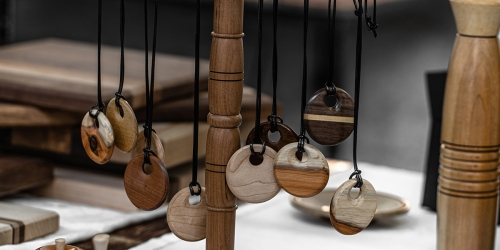 Turned wood necklaces handing on a stand